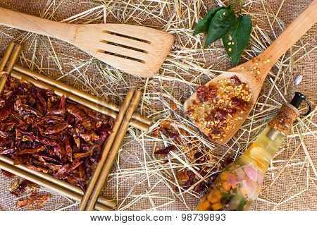 Wooden spoon dried crushed chili red pepper and whole dried chili peppers on burlap background poster