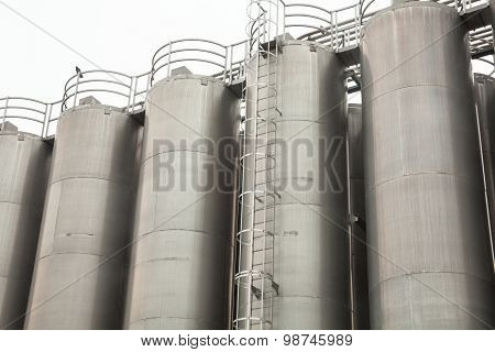 Metal Tower Silos Of The Industrial Plant