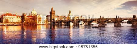 View of the Lesser Bridge Tower of Charles Bridge in Prague (Karluv Most) the Czech Republic. This bridge is oldest in the city and a very popular tourist attraction.Filtered image: vintage effect.