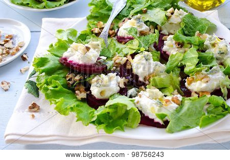 Beet Salad with goat cheese, walnuts, greens and herbs