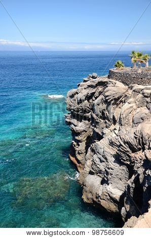 Turquoise bay and volcanic cliffs in Callao Salvaje on Tenerife, Spain