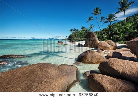 Deep Blue Sky And Beautiful Beach With Enormous Stones