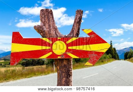 Macedonia Flag wooden sign with road background