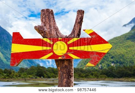 Macedonia Flag wooden sign with mountains background