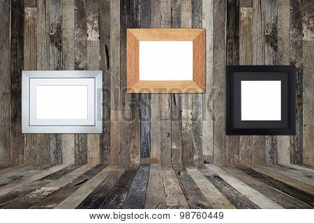 Wooden Picture Frames On The Old Wooden Wall