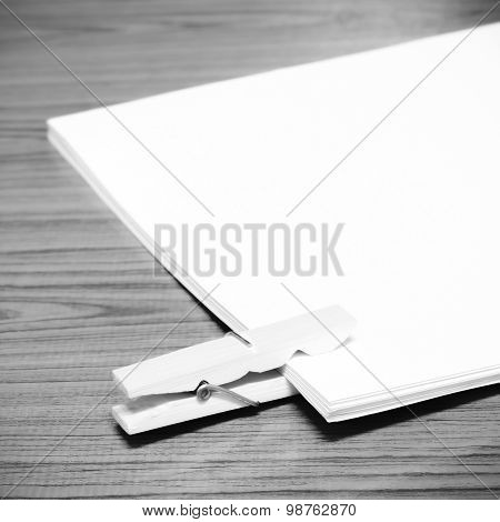 wooden pin paper on wood background black and white color tone style