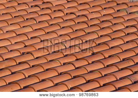 Orange tiles of a new home.  Beautiful background of clay tiles