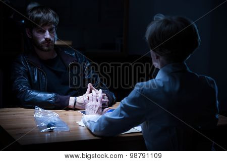 Policewoman Interrogating Young Criminal