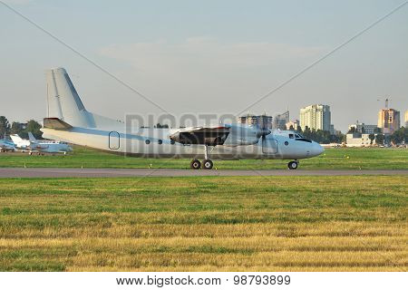 Old propeller passenger plane on the runway in the airport poster