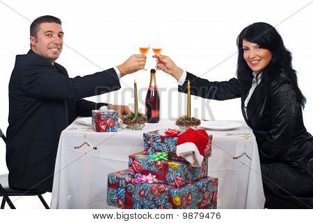 Couple Toast With Champagne At Christmas Dinner