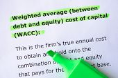 Weighted average (between debt and equity) cost of capital (WACC) words highlighted on the white background poster