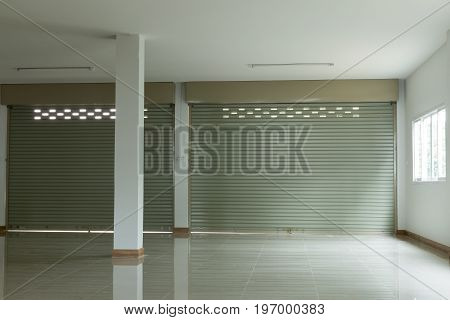 empty room in house residential building with aluminium roller shutter door closed