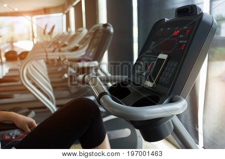 Woman Cycling Burn Fat On Bicycle Cardio Machine In Fitness Gym Exercise Sport Club Center