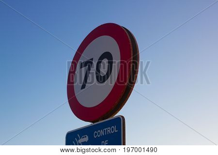 Isolated traffic sign. Seventy miles per hour speed limit sign round red