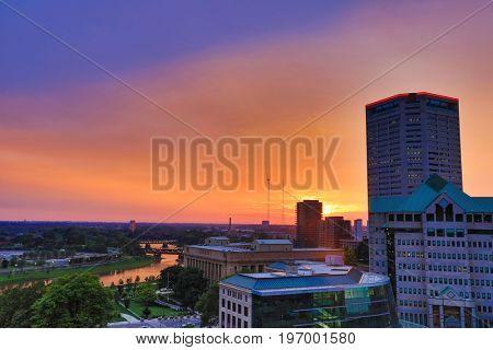 The Scioto River glows orange during sunset in Columbus, Ohio