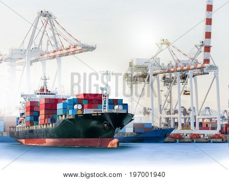 Logistics and transportation of International Container Cargo ship with ports crane bridge in harbor for logistic import export background and transport industry.