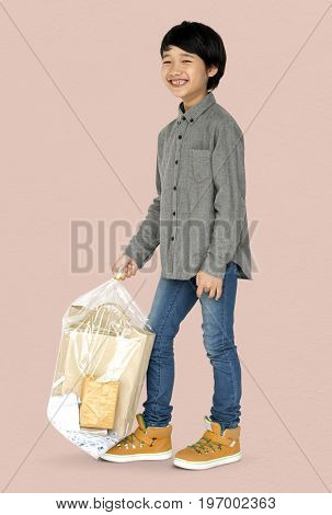 Little Boy Holding Separate Papers Studio Portrait