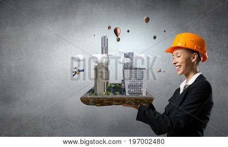 Woman presenting construction project. Mixed media