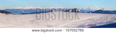 Panoramic wintry view from Velka Fatra mountains ridge to High Tatras mountains Slovakia