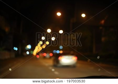 traffic light of driving car on city night street road abstract blur bokeh background