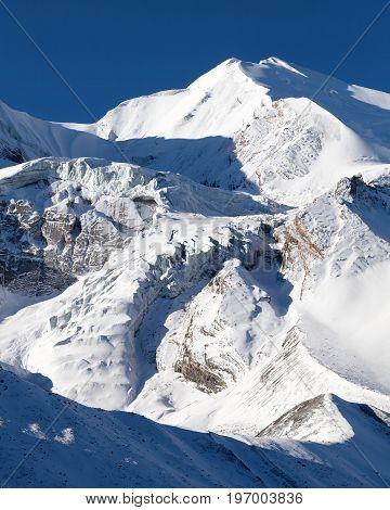 round Annapurna circuit trekking trail view from Thorung La pass Thorung Peak Nepal