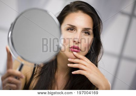 Seductive woman look and mirror