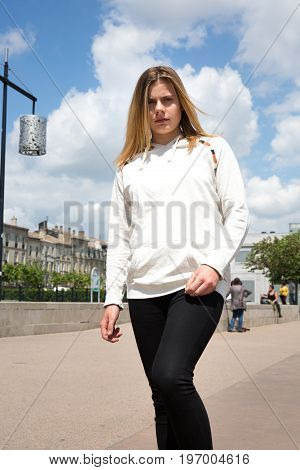 Blonde Teenager Girl In City Center In Summer Day