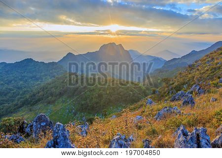 Sunset with clouds over top of mountain at Doi Luang Chiang Dao, Chaingmai, Thailand