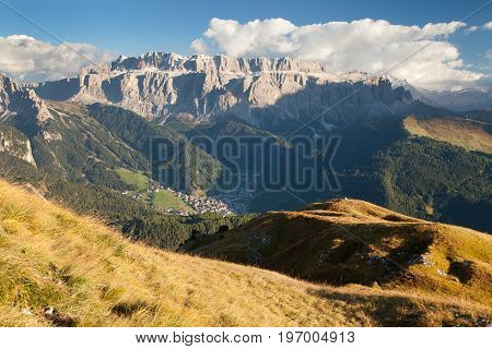Evening view of Sella gruppe or gruppo di Sella with clouds and Selva Val Gardena or Wolkenstein South Tirol Dolomites mountains Italy