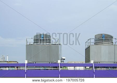Cooling towers on daylight on the purple floor