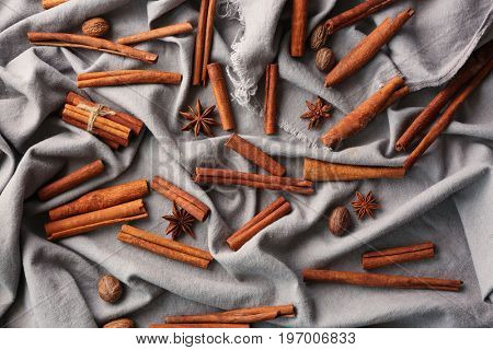 Cinnamon sticks and anise stars on tablecloth