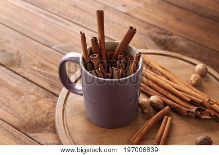 Composition with cinnamon sticks on wooden table