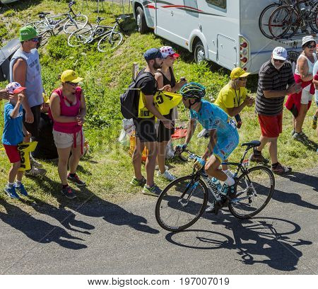 Col du Grand ColombierFrance - July 17 2016: The Italian cyclist Vincenzo Nibali of Astana Team riding on the road to Col du Grand Colombier in Jura Mountains during the stage 15 of Tour de France 2016.