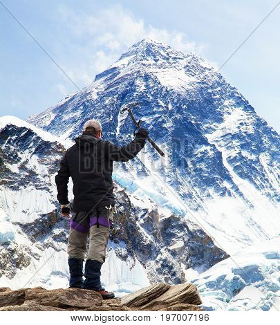 Panoramic view of Mount Everest from Kala Patthar with tourist with ice axe in hand on the way to Everest base camp Sagarmatha national park Khumbu valley - Nepal