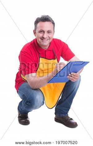 Smiling Salesman Counting Products On Supermarket Shelf