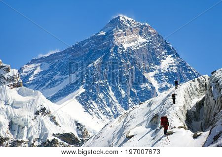 view of Everest from Gokyo valley with group of climbers on glacier way to Everest base camp Sagarmatha national park Khumbu valley Nepalese Himalayas