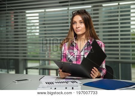 girl looks incredulous after reading the contract, young business woman unhappy with the result