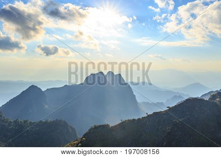 Sunset with clouds over top of mountain at Doi Luang Chiang Dao, Chaingmai, Thailand.