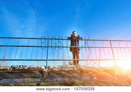 On A Concrete Bridge There Is A Calm Happy Woman Who Enjoys Hiki