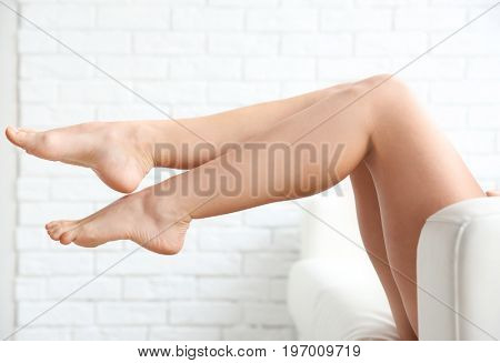 Female legs on light blurred background. Epilation concept