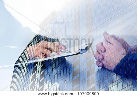 Concept of consulting. Double exposure of cityscape and people on business meeting