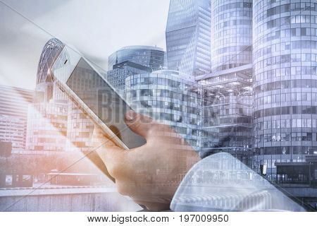 Concept of consulting. Double exposure of cityscape and woman using smartphone