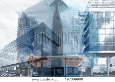 Concept of consulting. Double exposure of cityscape and businessman holding tablet