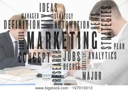 MARKETING word cloud and people in office on background