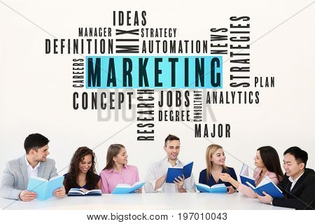 MARKETING word cloud and people with books on light background