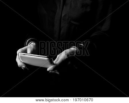 Female Hands Isolated On Black Writing Sms