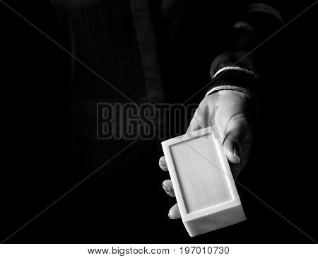 Woman Hand Isolated On Black Showing Bar Of Soap