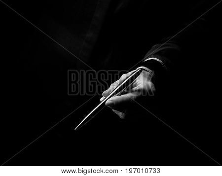 Female Hand Isolated On Black Giving Pen