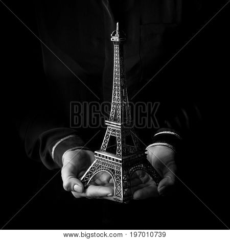 Female Hands Isolated On Black Background Showing Eiffel Tower