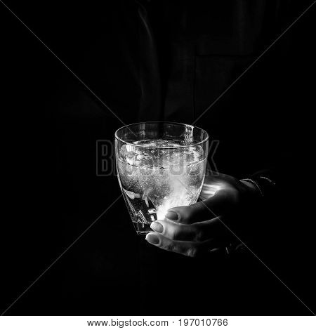 Woman Hand Showing Glass Of Water With Effervescent Tablet